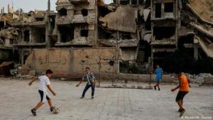 Children playing football in Damascus (photo: Reuters/M. Djurica)