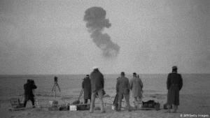 Officials watching a French nuclear test in the Algerian desert (photo: AFP/Getty Images)
