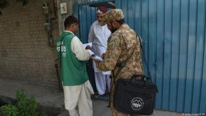 A Pakistani soldier collects information from an Ahmadi Muslim resident (photo: Getty Images/A. Ali)