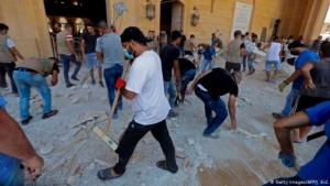 Volunteers sweep up debris following the August explosion in Beirut (photo: Getty Images/AFP)