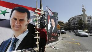 Bashar al-Assad election posters in Damascus, May 2021 (photo: AFP/Getty Images/Louai Beshara)