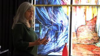 Mahbuba Maqsoodi in front of her work: in 2018, Maqsoodi won an international competition to design the stained glass windows at Tholey. Now the abbey in Germany's oldest monastery is getting thirty-four windows designed by a Muslim woman